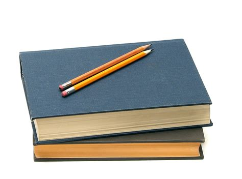Books Free Stock Photo A Stack Of Books And Pencils