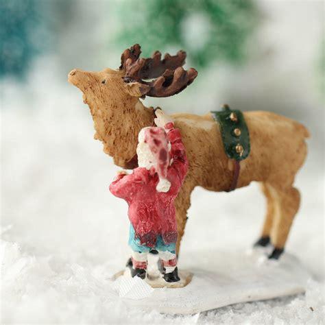 santa and reindeer figurines miniature santa and reindeer figurine