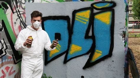 spray painter names spray painting my name on a wall