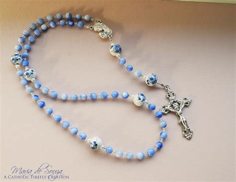 a rosary catholic firefly creations blue cat eye glass rosary