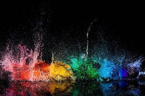 colored water strobe lights exploding water balloons