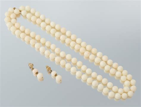 white coral bead necklace a white coral bead necklace and matching earrings 09 24