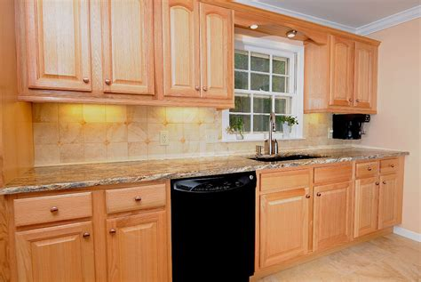 paint colors for kitchen cabinets with black appliances oak kitchen cabinets with black countertops oak kitchen