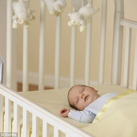 baby sleeps on side in crib soft but deadly parents warned about crib accessories