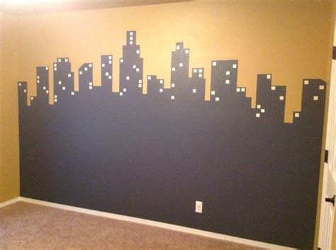 glow in the paint city city skyline painted on wall in gray paint with yellow