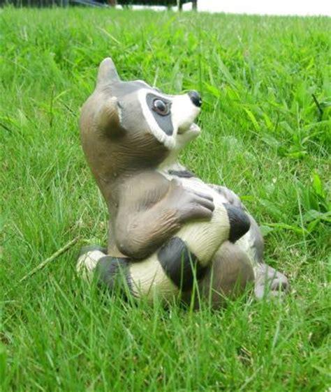 outdoor animals sitting raccoon animal garden statue outdoor lawn decor