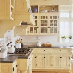 light yellow kitchen cabinets 1000 ideas about yellow kitchen cabinets on