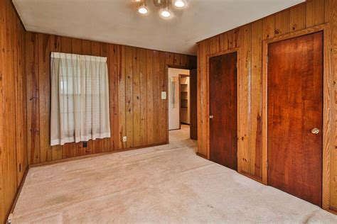 retro wood paneling time capsule house with spectular 1970s mediterranean