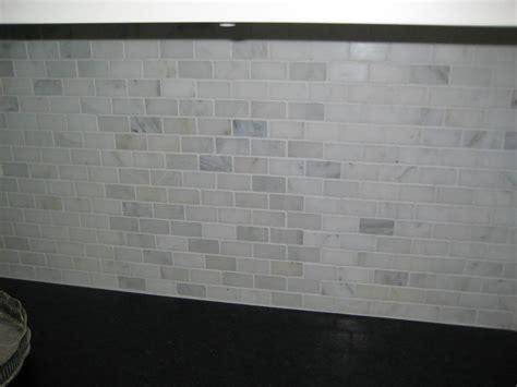 marble tile backsplash kitchen orangerie and blue kitchen renovation in progress