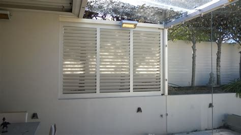 spray painting vinyl shutters our work