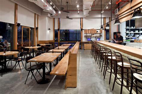 industrial look industrial look wood and concrete for giraffe restaurant