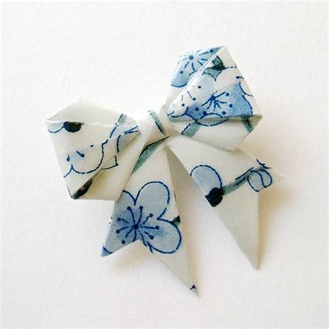 snow origami snow blossom washi paper origami bow brooch by matin lapin