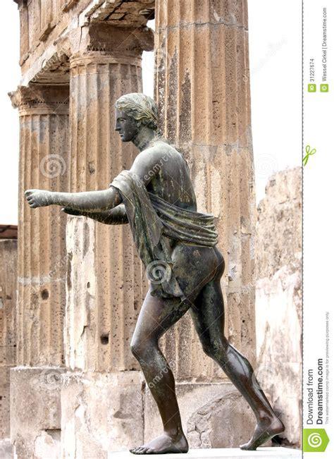 statue of apollo in the ruins of pompei italy stock