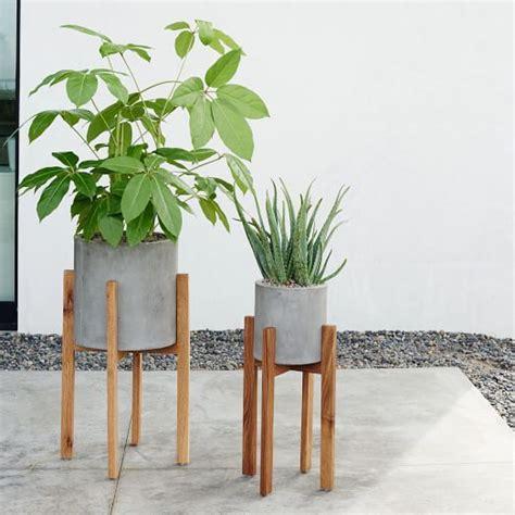 modern white planter modern wood leg standing planter cylinder west elm