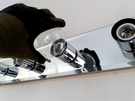 how to remove bathroom light fixture how to replace a bathroom light fixture replace letter