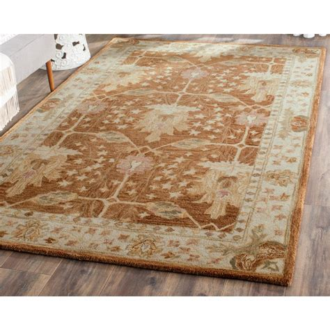 5 ft area rugs safavieh antiquity rust gold 5 ft x 8 ft area rug at249c
