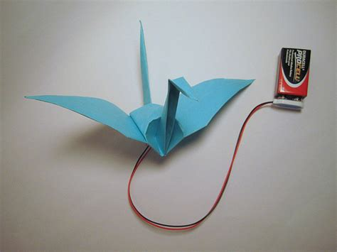 origami crane with flapping wings high low tech electronic origami flapping crane