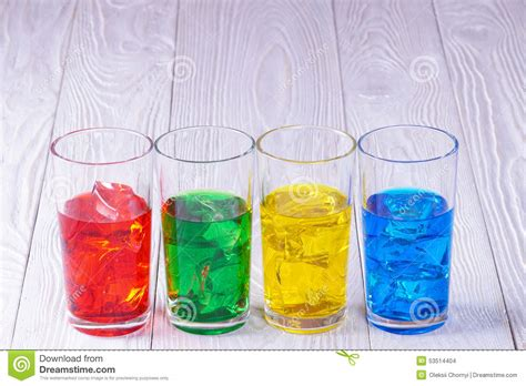 colored water glasses with colored water and stock photo image