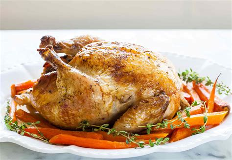 roast whole chicken roast chicken with carrots recipe simplyrecipes