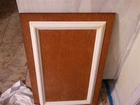 adding trim to cabinet doors add trim and a new coat of paint to cabinets for a