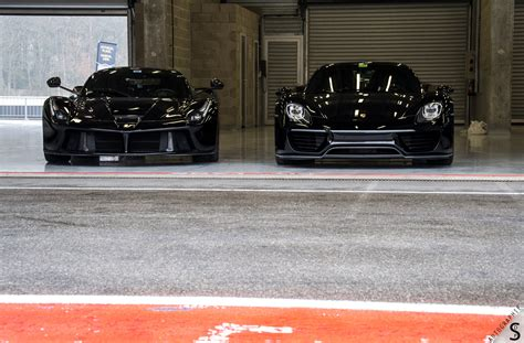 black laferrari and black porsche 918 spyder by s defaux