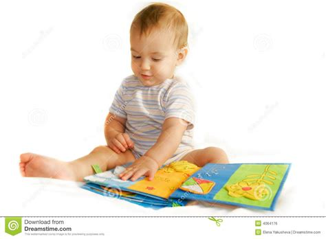 baby picture book baby boy reading a book royalty free stock image image