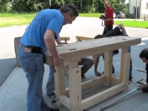 traditional woodworkers assembling a traditional workbench