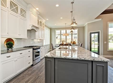accent color for white and gray kitchen white kitchen cabinetry with grey accent island chrome