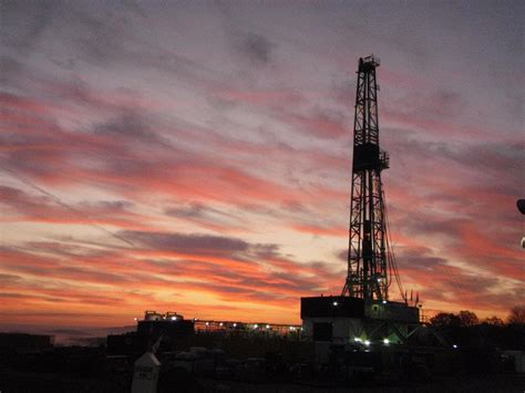 silhouette through sunrise oilfield drilling rig
