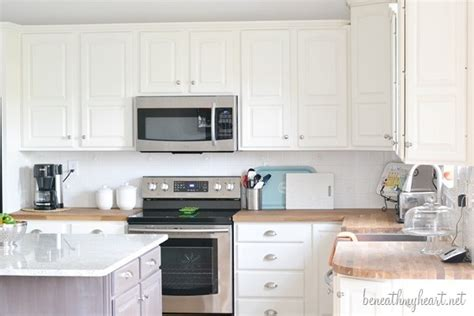 painting oak kitchen cabinets white kitchen makeover reveal beneath my