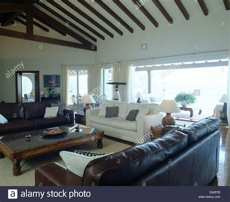 white sofa in living room brown leather sofas and white sofa in modern coastal