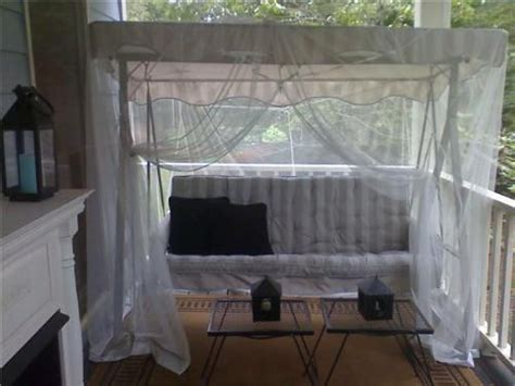 mosquito netting over swing outdoors deck patio space