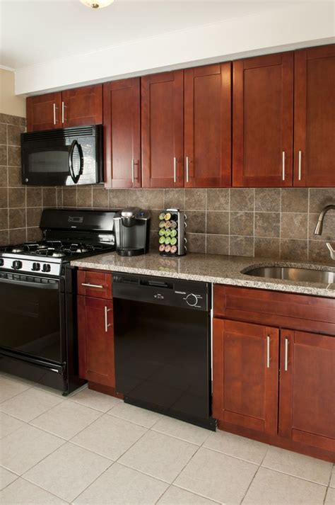 Cherry Cabinets by Cherry Cabinets Granite Countertops Black Appliances