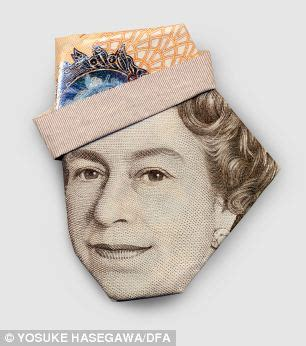 uk money origami gandhi in a baseball cap and the in a turban it