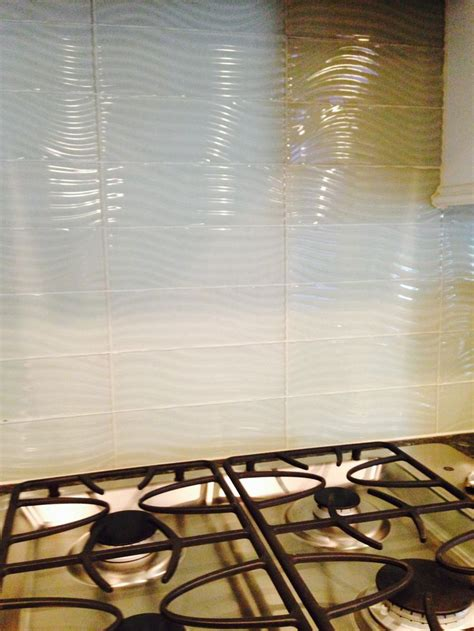 wave glass tile backsplash built in stainless steel gas cooktop with wave textured