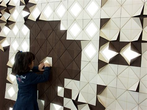 interactive origami light form gorgeous wood wall panels flip up to reveal