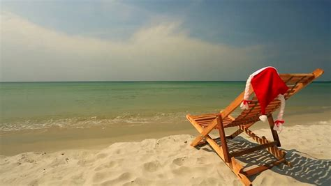 turquoise santa hat sunlounger with santa hat standing on beautiful tropical