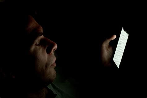 looking at lights person looking at smartphone in the a