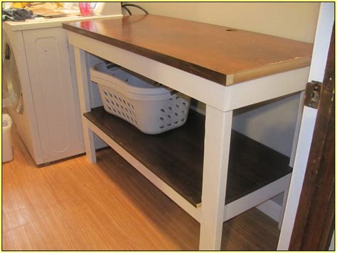 Wood Canopy Bed laundry room folding table home design ideas