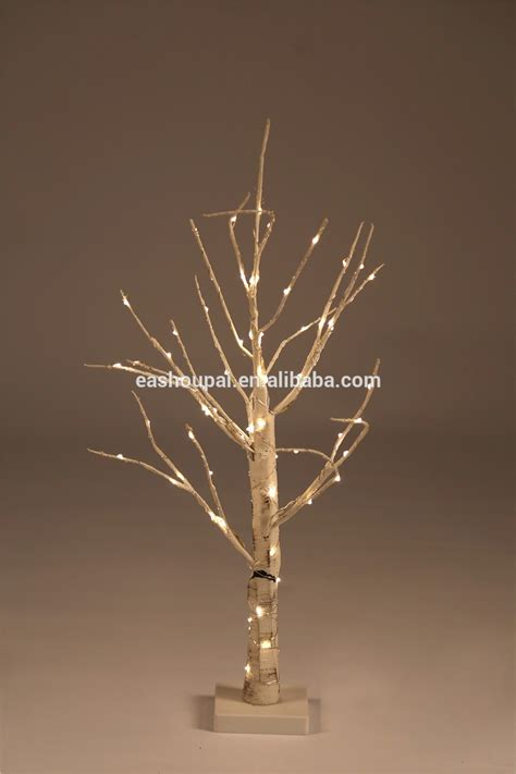 white wire tree lights copper wire wrapped big white artificial tree