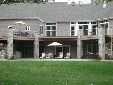walkout basement walk out basement with pool patio and deck above deck decor chairs pools and decks