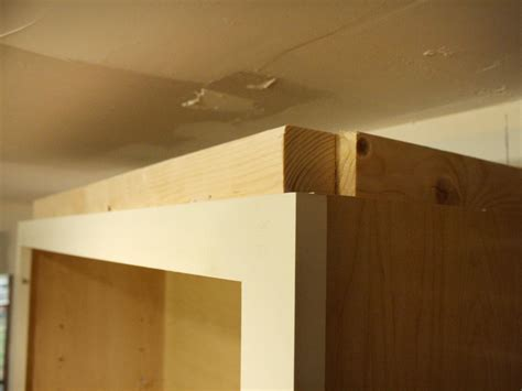 attaching crown moulding kitchen cabinets how to install cabinet crown molding how tos diy