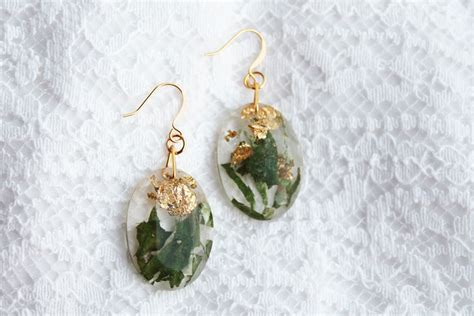best resin for jewelry real flower petals and gold flakes in resin jewelry by