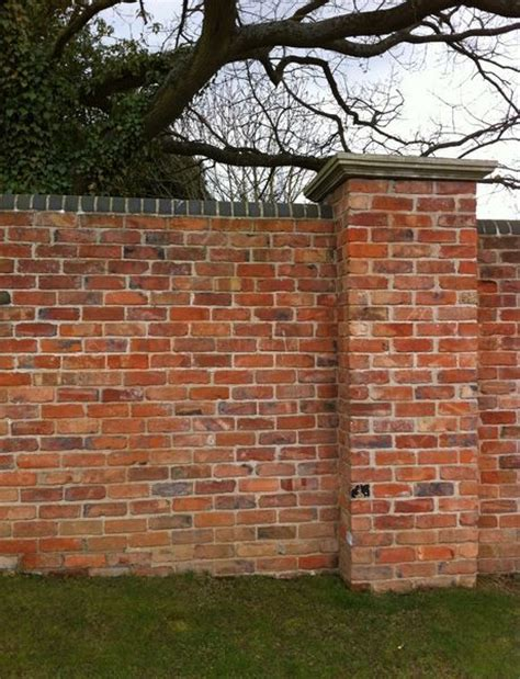 brick walls for gardens walled garden brick wall with piers shown here with blue