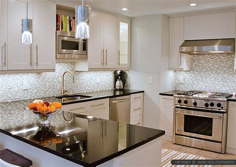 white kitchen cabinets black granite countertops black countertop backsplash ideas backsplash