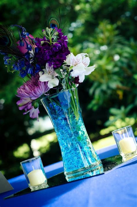 purple water centerpieces pin by miller harnesk on wedding