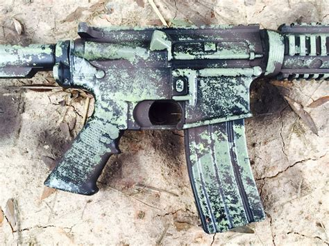 spray painting rifle blue gear how to camo your rifle with a sponge