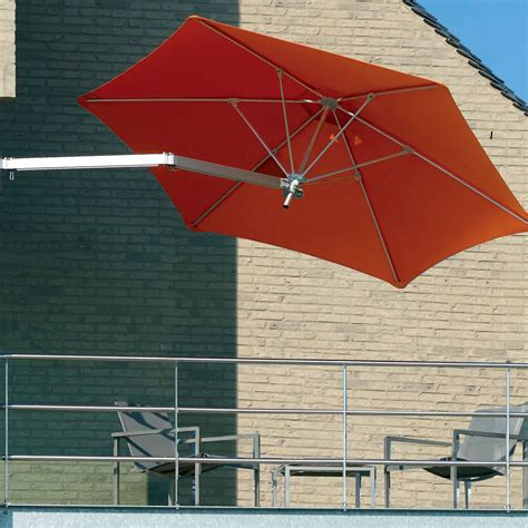 the wall mounted patio umbrella hammacher schlemmer
