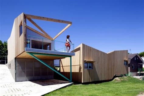 A Frame Style House house on a hill with a seven volume modular building