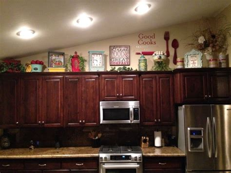 decorate top of kitchen cabinets how to decorate on top of cabinets with vaulted ceiling